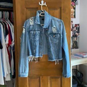 a ripped jean jacket